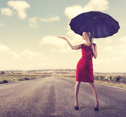 Protection concept. Girl with umbrella over cloud sky background