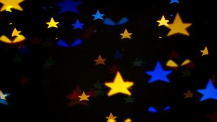 Colorful defocused blinking star shaped festive lights