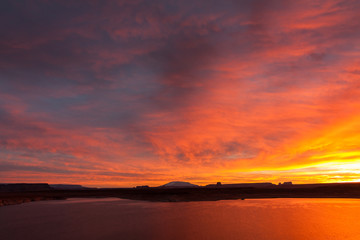 Lake Powell at sunrise, clouds and sunlight