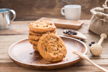 Pile of cookies on a wood dish