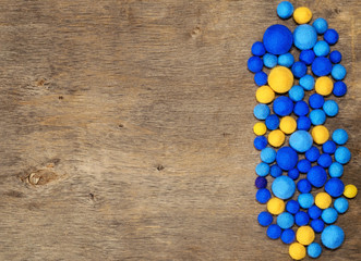 blue and yellow beads from felt and place for text