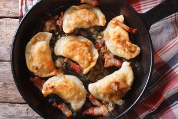 fried dumplings in a pan macro. horizontal top view