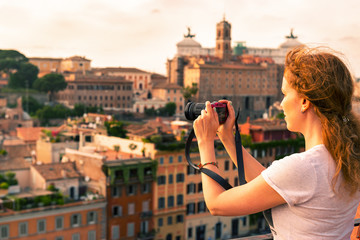 Girl takes a picture in the Palatine Hill in Rome