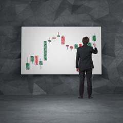businessman drawing candlestick chart