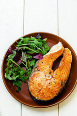 grilled salmon on a salad of arugula