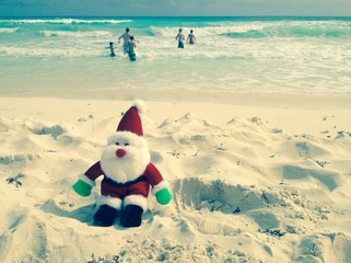 Christmas time on tropical beach with Santa, toned image