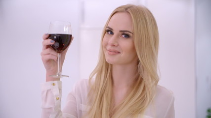 Adorable Blond Woman Rising Her Glass