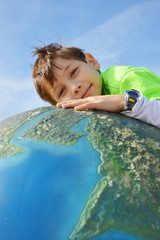 child holding Earth in hands