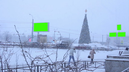 billboard green screen near Christmas tree