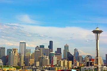 Seattle city landmarks and Mt. Rainier at sunset.