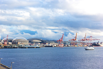 Late afternoon sun touched Seattle port pier.