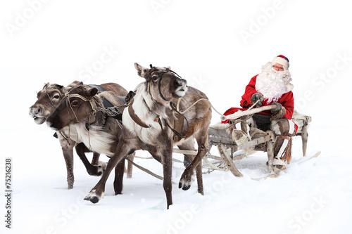 Leinwanddruck Bild Santa Claus is sitting in a deer sleigh
