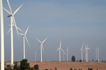 wind turbine against cloudy blue sky background