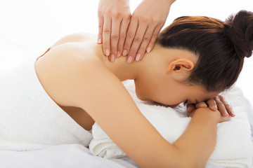 massage of neck for woman in spa salon