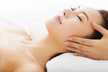 massage of face for woman in spa salon