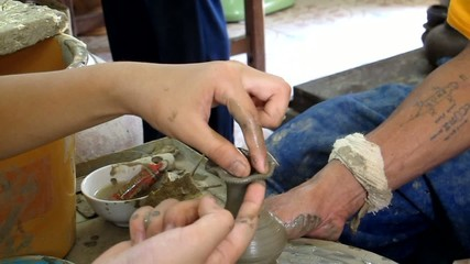 Teaching Traveler Child make pottery at Koh Kret Island