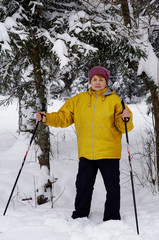 An old woman skiing in the forest