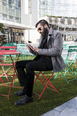 young hipster businessman consults his laptop