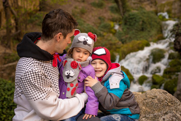 Fathet and two children near a waterfall