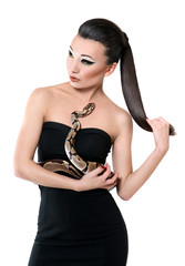 Portrait of a beautiful girl with a snake in hands