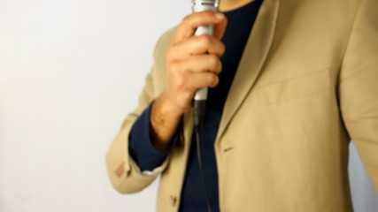 blurred interviewer holding a microphone over white background