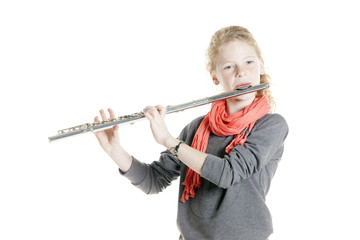 young girl with red hair and freckles plays flute