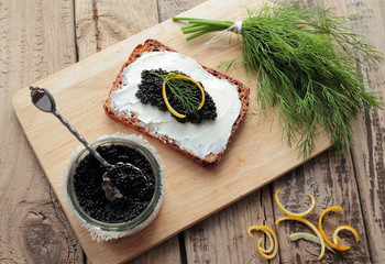 Bread with black caviar and cream cheese. Angle view