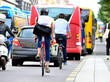 Leinwanddruck Bild - People on bikes in traffic