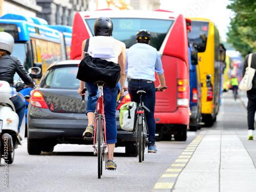 Leinwanddruck Bild People on bikes in traffic