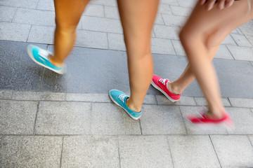 Summer women walking on sidewalk