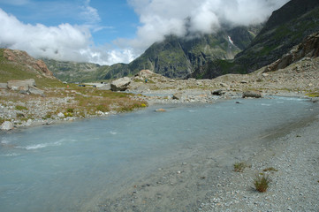 Gill in valley nearby glacier in Alps in Switzerland