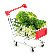 Giant broccoli bunches in market shopping store cart isolated on