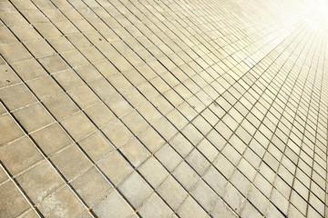 Tiled sidewalk and light