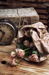 retro bouquet of roses and old-fashioned clock