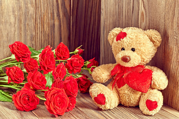 Valentines Day. Teddy Bear Loving with bouquet of Red Roses