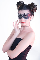 Posing young girl with dramatic make up