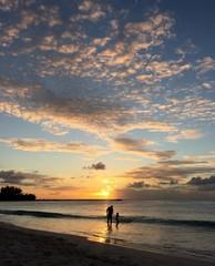 man & child at sunset