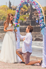 man makes a proposal to his girlfriend