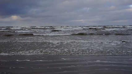 Sea in December storms and waves beat against the shore