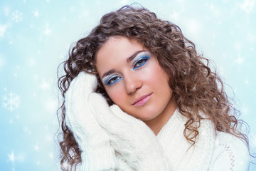 Young beauty woman in winter clothes