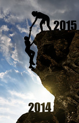 Silhouette girls climbs into the New Year 2015