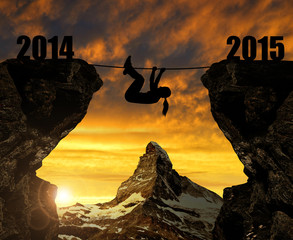 Girl climbs into the New Year 2015. In the background Matterhorn