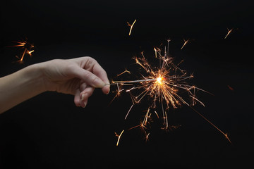 woman's hand holding a sparkler
