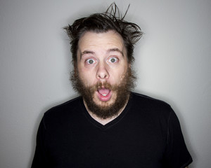 bearded man looking at the camera shocked