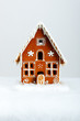 The hand-made eatable gingerbread house and snow decoration - 75239026