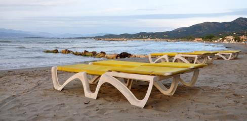 loungers on the beach near the sea