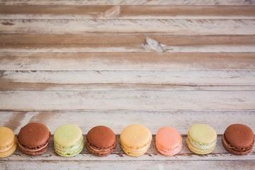 Macarons in row on bottom