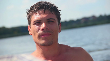 Close-up of young shirtless man paddling boat. Tourism, vacation