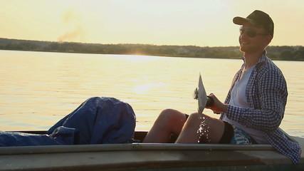 Young smiling man kayaking, enjoying active rest, vacation