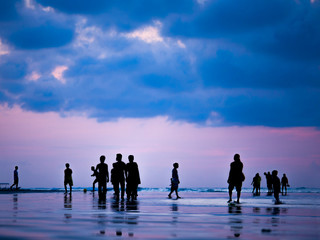 Silhouettes of people at sunset on the beach of Kuta Bali I